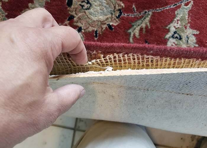 Inspecting a damaged rug